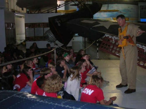 Commander Hills giving a World War II naval aviation talk to E. L. Wright middle school students.