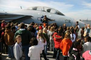 Whitesides Elementary school 5th graders learn about the F-14 Tomcat Fighter from Commander Butch Hills.