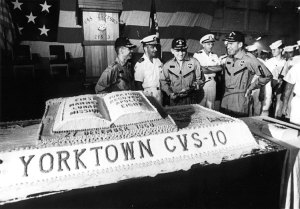 Astronauts Borman, Anders and Lovell prepare to eat cake!