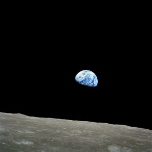 The good earth rises above the moon.