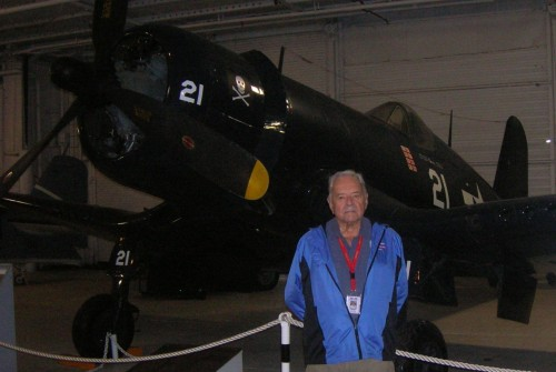 World War 2 Marine fighter pilot Bill Cart in front of Patriots Point Corsair.