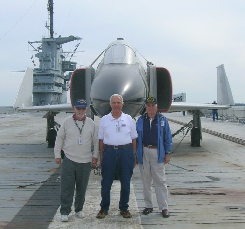 Volunteers Tom Waldron, Lloyd Conard and Dick West stand in front of our F-4J Phantom.