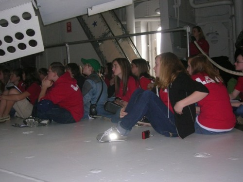 E. L. Wright students beneath the dive flaps (see the holes in the flaps to prevent flutter) of the SBD, which helped make it the most deadly bomber in the Pacific War.