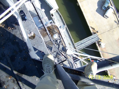 Looking down at the pier from 30 feet above the O-11 level on USS Yorktown (CV-10).