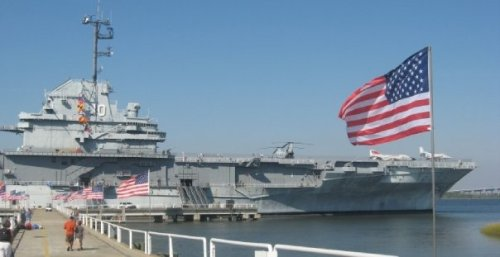 USS Yorktown and a pier of flags.