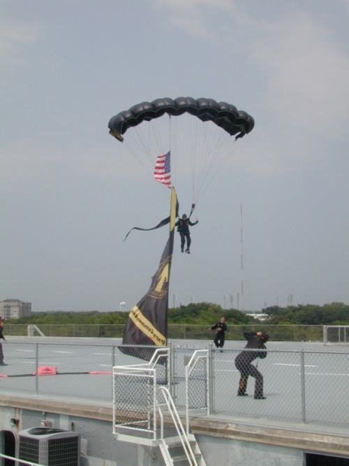 Special Operations Command parachutist coming in on the flight deck of Yorktown.
