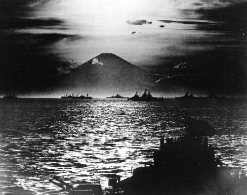 With Allied warships anchored in Sagami Wan, the sun sets behind Mt. Fugiyama and on the Japanese Empire.