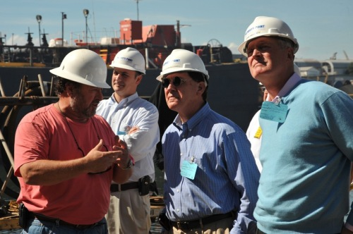 Senator McConnell and PPDA Chairman Hagerty listen to Detyen's shipyard workers explain their work.